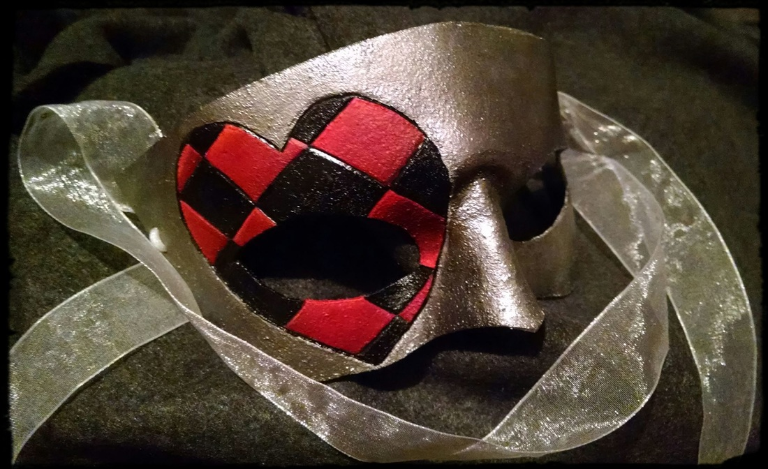 small leather mask, silver with heart tooling